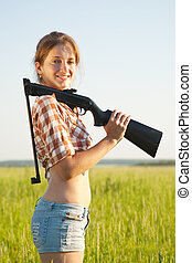 Girl with pneumatic air rifle - beautiful young girl with...