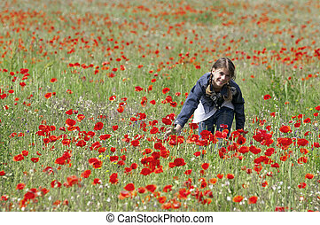 Girl with poppies touching