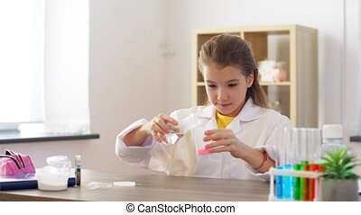 girl with powder making slime at home laboratory - chemistry...