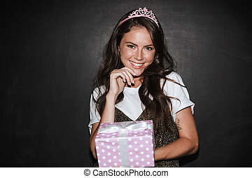 Girl with present gift box isolated