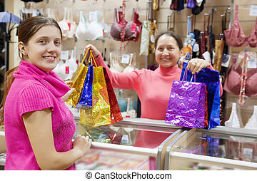 Girl with purchases at  counter