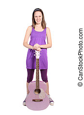 Girl with purple accoustic guitar - Teenaged girl standing...