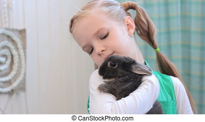 girl with rabbit posing during photo session