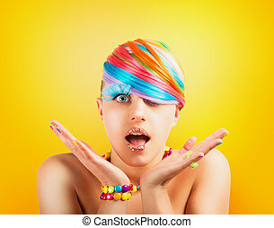 Girl with rainbow colorful fashion makeup on yellow background