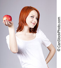 Girl with red apple in hand