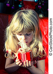 girl with red christmas surprise box