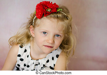 girl with red flower in hair portrait