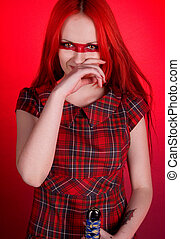 Girl with red hair and a sword