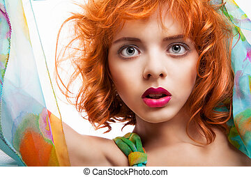 Girl with red hair and colorful dress over white