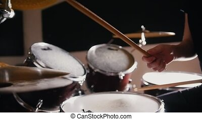 Girl with red hair playing drums, close up