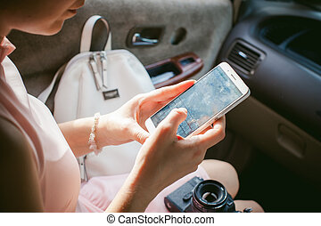 girl with red hair sitting in the car, to make payments for online purchases from your device using a bank debit card. online payments, bank transfers.