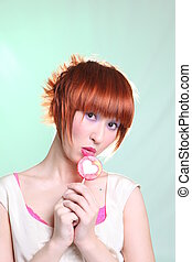 Girl with red hair with a lollipop