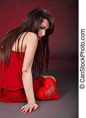 Girl with red heart  in depression.