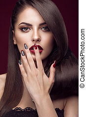 girl with red lips and manicure