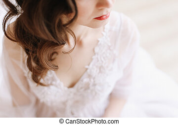 Girl with red lips in profile. Close-up portrait of a young woman. Wedding details. Morning of the bride.