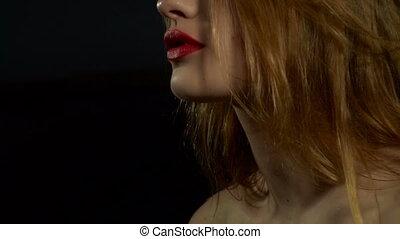 girl with red lipstick sprays perfume