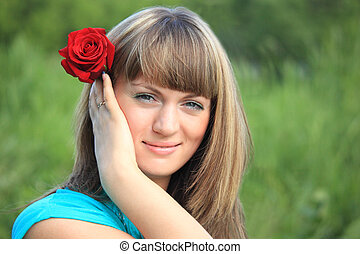 girl with red rose in hair