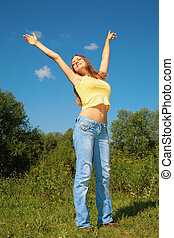 Girl with rises hands in park, full body