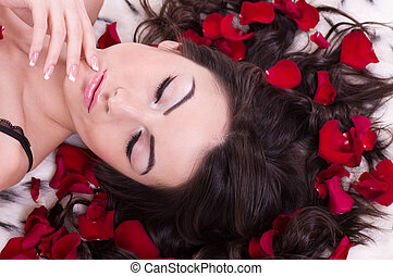 girl with rose petal in hears.