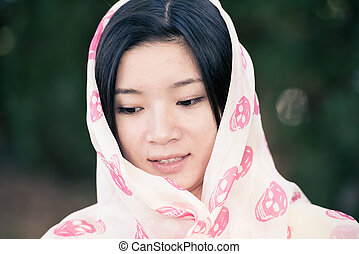 Girl with scarf covering head