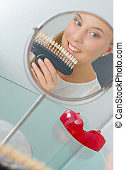 girl with set of artificial teeth
