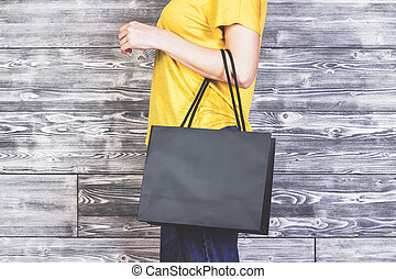 Girl with shopping bag side - Sideview of girl with blank...