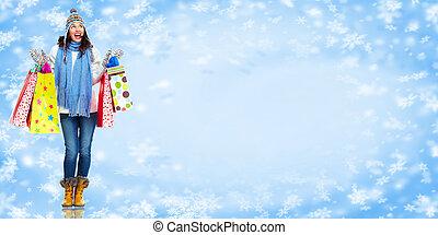 Girl with shopping bags. Christmas sale.