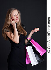 Girl with shopping on the phone