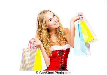 Girl with shoppingbags dressed in Santa uniform