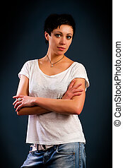 girl with short hair wearing a white t-shirt and jeans...