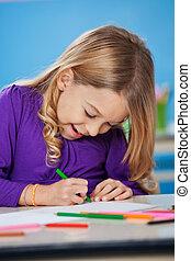 Girl With Sketch Pen Drawing In Kindergarten