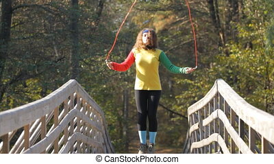girl with skipping rope - girl jumping with skipping rope on...