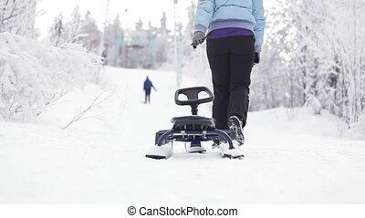 Girl with sledge