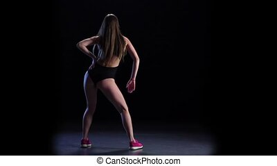 Girl with slender body dancing. Slow motion