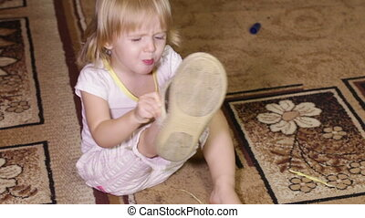 Girl with slippers - Little girl wearing big slippers mom