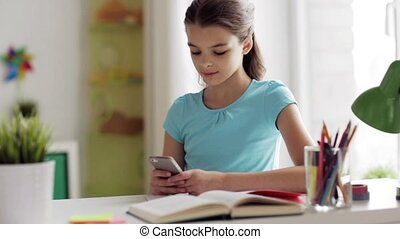 girl with smartphone distracting from homework