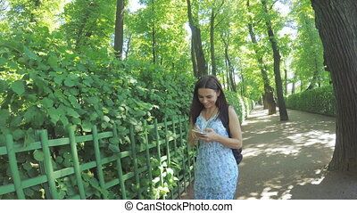 Girl with smartphone in park
