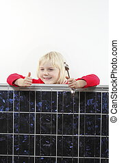 girl with solar panel and wrench is smiling