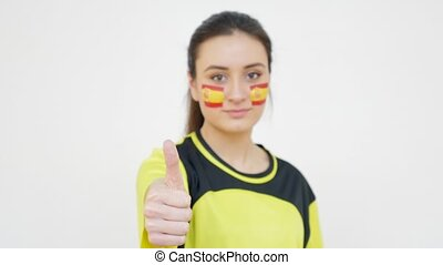 Girl with Spanish Flag Showing Thumb Up and Sending an Air...