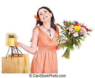 Girl with spring flower, shopping bag and gift box.