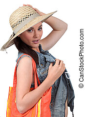Girl with straw hat on white background