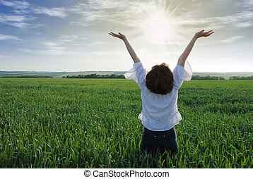 girl with sun light - The girl on a field. The woman with...