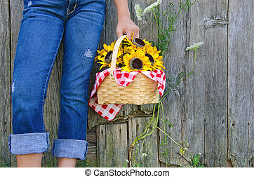 girl with sunflowers in a basket