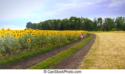 Girl with sunflowers.