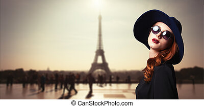 Girl with sunglasses and Parisian background