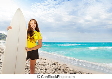Girl with surfing board on the sea