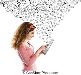 Girl with tablet - Beautiful young girl with tablet is using...