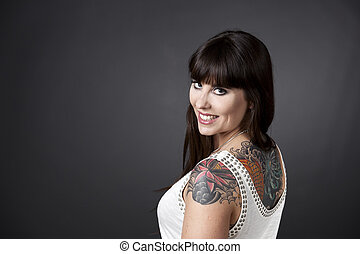 Girl with Tatoos - Portrait of a beautiful young woman with...