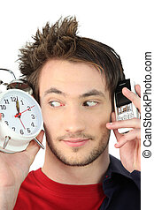 Girl with telephone and alarm clock