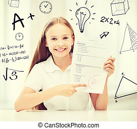 girl with test and A grade at school - education and school...